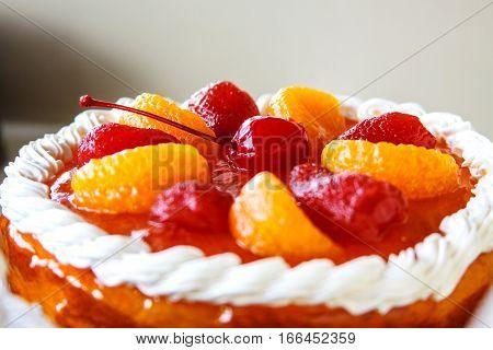 Orange cream cake with mixed fruity, fruity cake