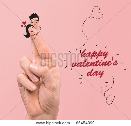 A happy couple in love with painted faces on fingers. The happy Valentine's Day concept