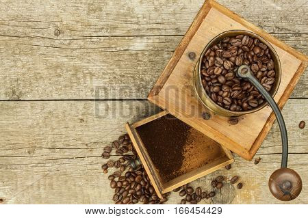 Old Wooden Coffee Grinder On A Wooden Table. Homework Hot Coffee. Advertising For The Sale Of Coffee