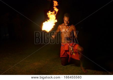 Indigenous Fijian Man Holds A Torch During A Fire Dance