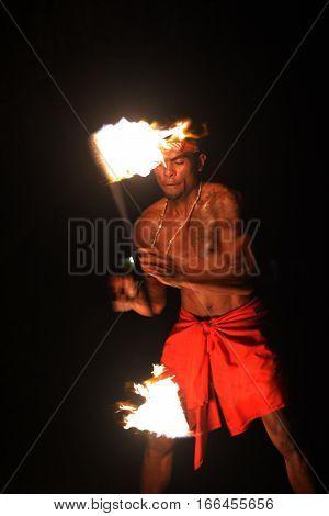 Indigenous Fijian Man Holds A Torch During A Fire Dance