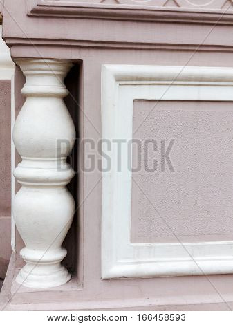 Element of old plaster old balustrades. Gypsum balusters as an element of external decorations Victorian in the Empire style. Vintage architectural element as a background.