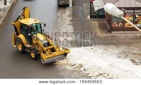 Odessa Ukraine - January 21 2017: People and special equipment to remove snow from city streets