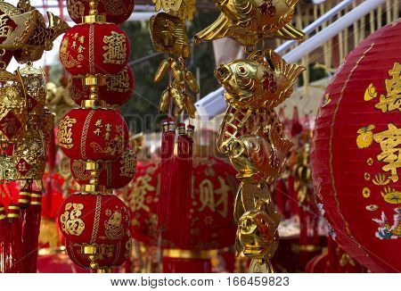 traditional decor for chinese new year small red paper lanterns with ornament and gold fish close up selective focus