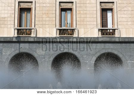 Varese (Lombardy Italy): old building and fountain in Monte Grappa square