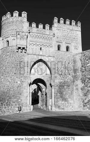 Toledo (Castilla-La Mancha Spain): the medieval door known as Puerta de Valmardon. Black and white