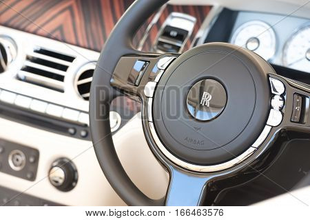 LAVERSTOKE, UK - AUGUST 25: Luxurious steering wheel and dashboard closeup from a Rolls Royce Ghost automobile at the CarFest South motoring event in Laverstoke, UK on August 25, 2016