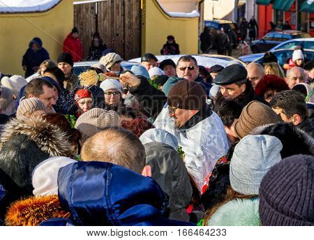Uzhgorod Ukraine - January 19 2017: Greek-Catholic priest (C) conducts a ceremony blessing parishioners during the celebration of the Epiphany Day. Epiphany Day completes the Christmas-New Year festivities cycle in Ukraine.