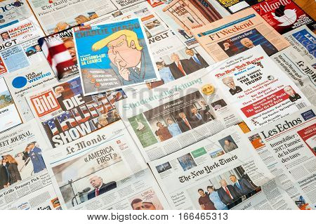 PARIS FRANCE - JAN 21 2017: Charlie Hebdo and major international newspaper journalism featuring headlines with Donald Trump inauguration as the 45th President of the United States in Washington D.C