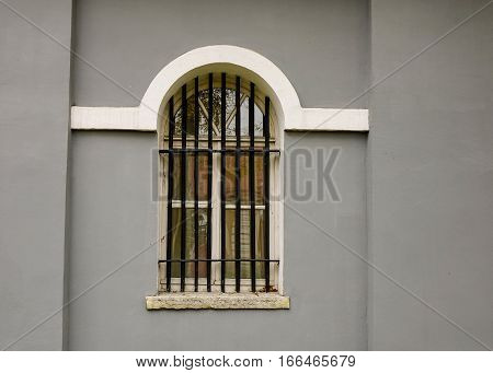 Window On The Gray Brick Wall Of Old Building