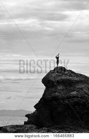 Silhouette Of Fijian Man Stands On A Sea Cliff In Fiji