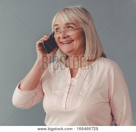Beautiful Mature Woman With Gadget
