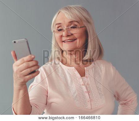 Beautiful Mature Woman With Gadget