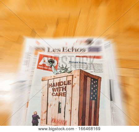PARIS FRANCE - JAN 21 2017: Algemeen Dagblad Dutch magazine above major international newspaper journalism featuring portrait of Donald Trump inauguration as the 45th President of the United States in Washington D.C