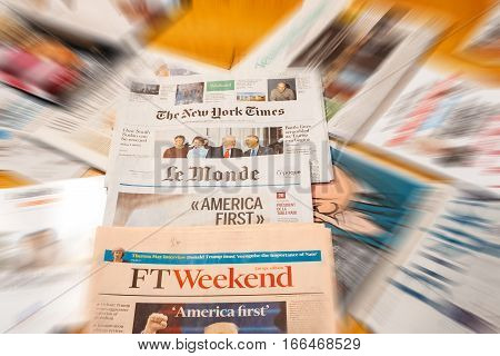 PARIS FRANCE - JAN 21 2017: Major international newspaper journalism featuring headlines with Donald Trump inauguration as the 45th President of the United States in Washington D.C