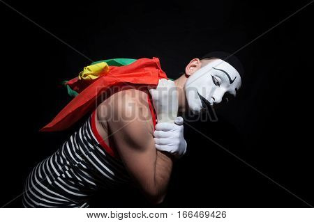 Portrait of mime with colorful shopping bags on black background