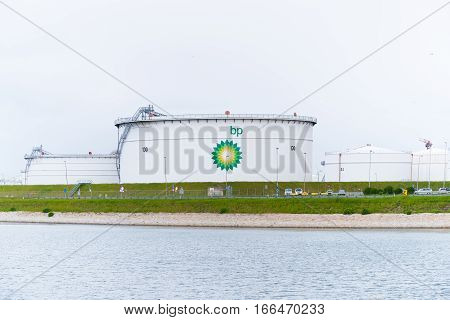ROTTERDAM NETHERLANDS - MAY 14 2016: large BP oil tanks in the rotterdam harbor area.