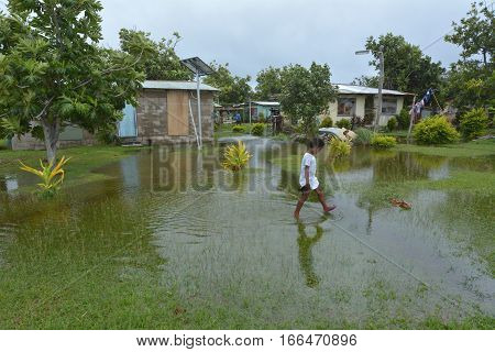 FIJI - DEC 17 2016:Indigenous Fijian girl (Miriam Bulivono age 8) in flooded land in Fiji. On Feb 2016 Severe Tropical Cyclone Winston was the strongest tropical cyclone in Fiji in recorded history.