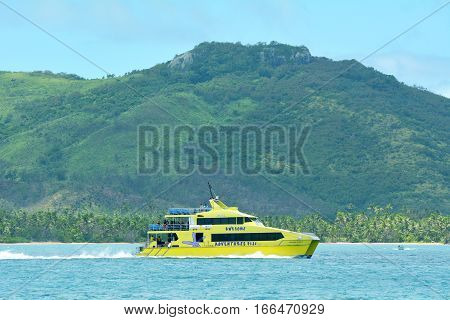 FIJI - DEC 20 2016: The bright yellow and fast catamaran Yasawa Flyer Fiji. It's a famouse high speed ferry transfers between the main island on Fiji and Yasawa & Mamanuca Island resorts.