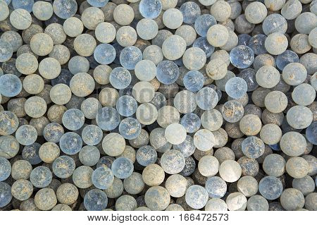 Close up of old shabby glass balls background