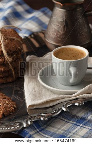 Evening with coffee and oat cookies on table