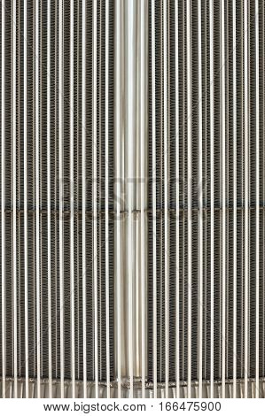 closeup abstract of a vintage chromed vehicle grille