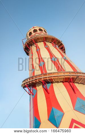 old fashioned theme park helter skelter ride against a blue sky background