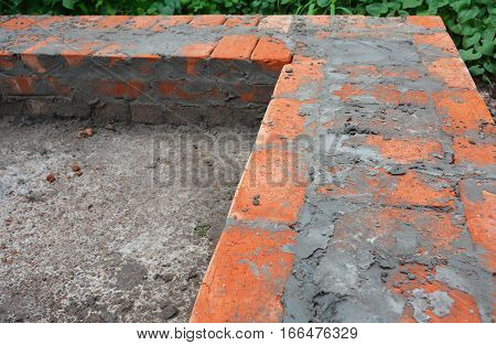 Close up on bricklaying house wall foundation