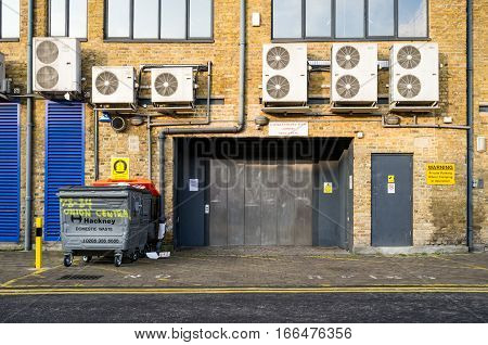 LONDON UK - 17 NOVEMBER 2011: The rear of a London business in Hackney East London with air conditioning units and other industrial elements.