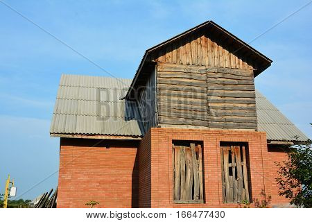 Building brick house construction with asbestos roofing