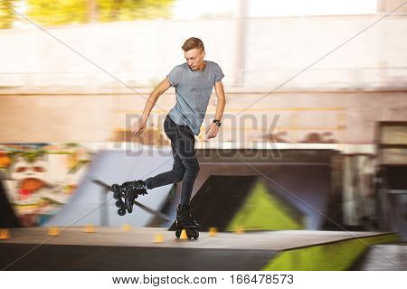 Man rollerblading in skatepark. Inline skater on blurred background. Generation of extreme.