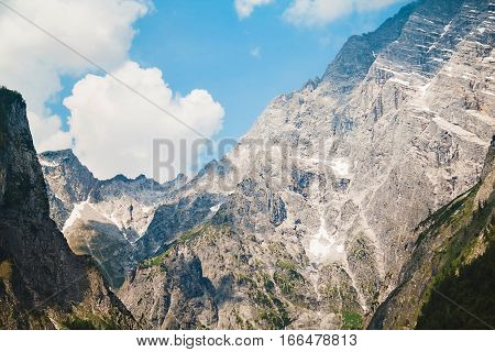 Clouds, Blue Sky And Peaks Of Mountains In Berchtesgaden National Park, Bavaria,  Germany