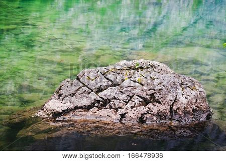 A Rock In Obersee Lake With Clear Green Water And Reflection, Berchtesgaden National Park, Bavaria,