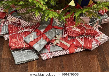 Gifts lying under Christmas tree.Celebration of New Year at home
