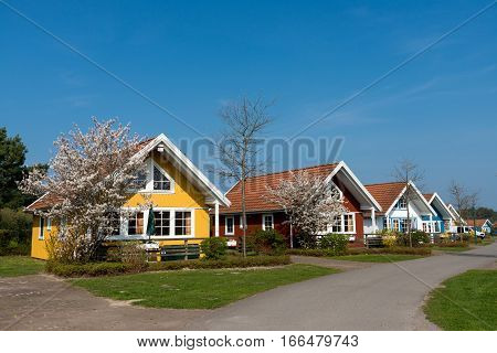 Wooden Bungalows And Garden On Campsite