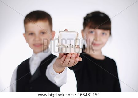 little boy and girl giving box with ring