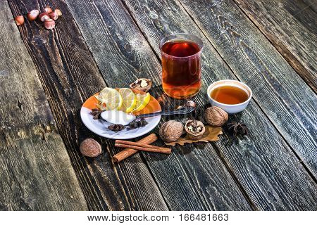 Grog - a traditional Scandinavian mulled wine with spices. Hot drink with tea wine honey and cinnamon.