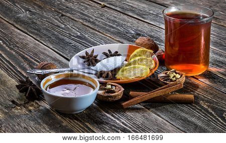 A glass of traditional hot mulled wine. Lemon honey and cinnamon.