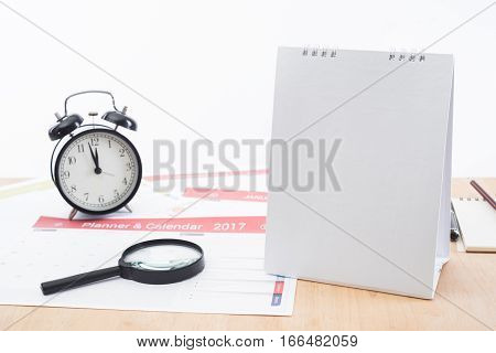 magnifier and clock with business Calender Planner 2017 on desk office. organization management remind concept.
