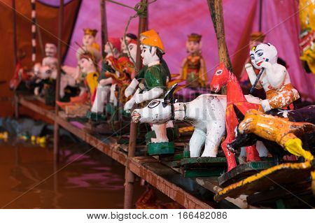 Common Vietnamese water puppets behind puppetry state. The control room is dark to hide puppeteers and instruments