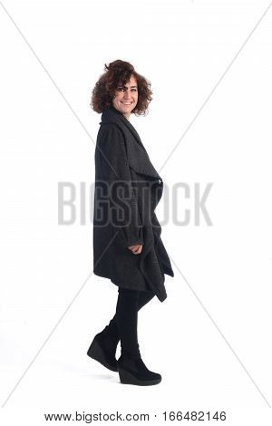 Attractive woman walking on a white background