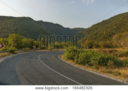 Mountain road and road sign in Central Balkan mountain, Beklemeto or Trojan pass, Stara Planiana, Bulgaria
