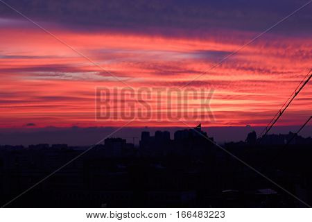 Wonderful view from window in twilight on sunset in urban zone