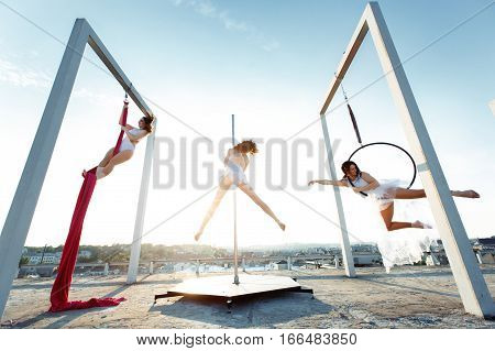 Athletic Dancers Performing Aerial & Pole Dance On Rooftop
