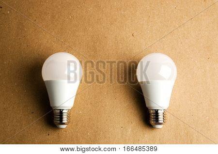 several LED energy saving light bulbs use of economical and environmentally friendly light bulb concept on a brown backgroun