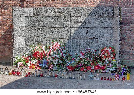 AUSCHWITZ-BIRKENAU CONCENTRATION CAMP, KRAKOW, POLAND - CIRCA JUNE 2012: Auschwitz death wall located near block 11