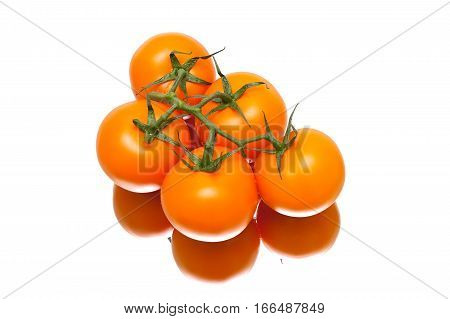 bunch of ripe tomatoes on a white background with reflection. horizontal photo.