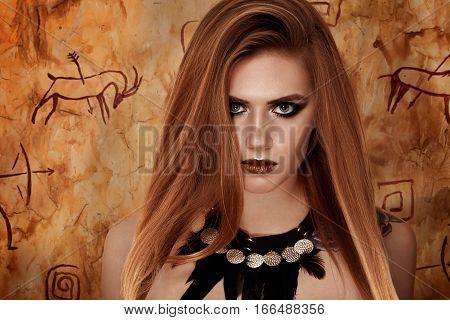 wild style portrait model, primitive cave background