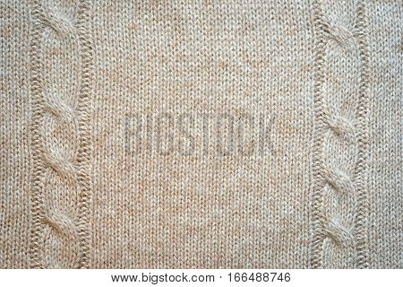 Knitted Background Pattern With Braids, Wool Neutral Beige Color. Copy Space For Your Text In The Mi