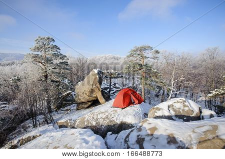 Tent In Snow Standing On The Top Of Rocky Mountain